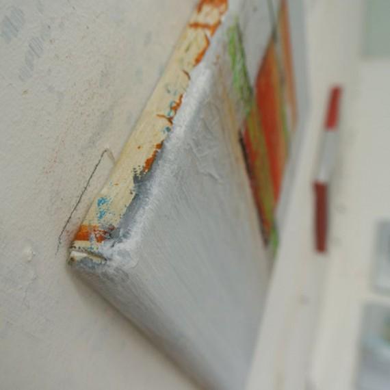 de zijkant van het schilderij vertelt veel over de opbouw